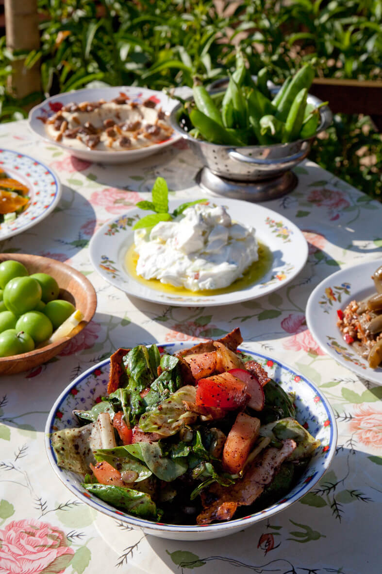Our fattouch, Sour plums, Our labneh mix, Green peas, Hommos with awarma meat.